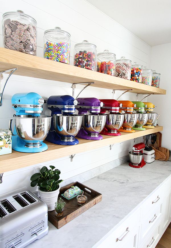 Take a step inside this beautiful pantry designed by Maria and Josh of @twopeasandpod. It features a gorgeous rainbow wall of KitchenAid® Stand Mixers along with other KitchenAid® appliances. Can you say pantry goals? Read their story on our blog: http://blog.kitchenaid.com/look-inside-pantry/