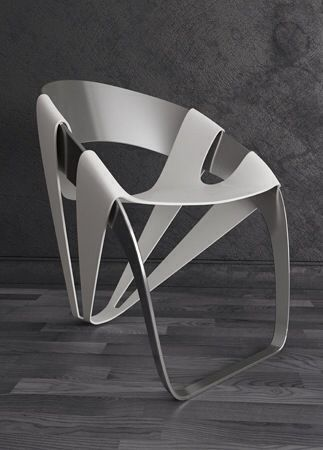 Dry Leaf Chair by Wilmer Chaca. This unusual chair is created using additional pieces of plastic which creates the frame work of the chair. I feel that this is an unusual way to look at a chair, but if an interior has the space to use these chairs then it will look really well within an interior.