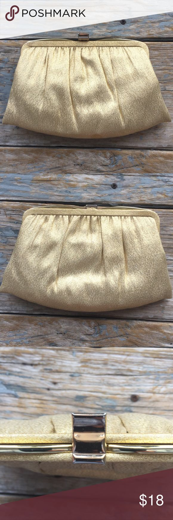 Vintage Andi Gold Clutch Vintage Clutch by Andi. Gold lame fabric with gold frame. There is a small stain on the bottom. I've not yet tried to remove it but I didn't notice it at first. Inside has wear, but it has double compartments and that's awesome. Gold chain. Vintage Bags Clutches & Wristlets