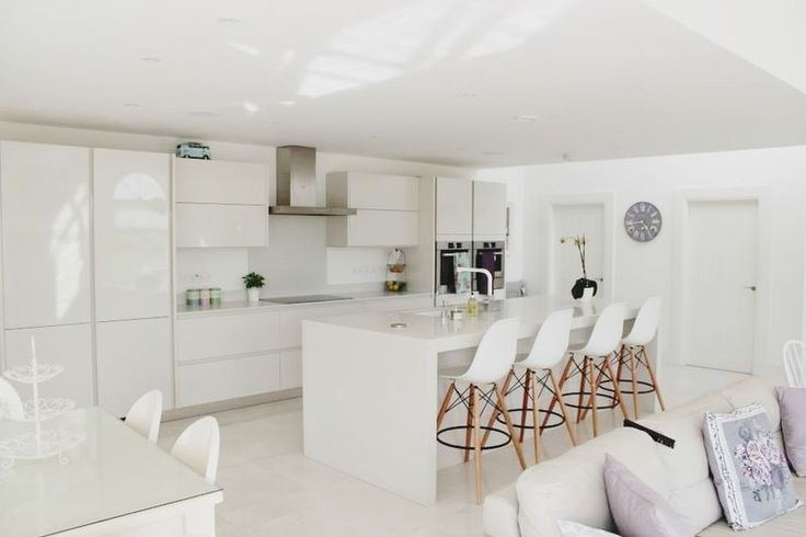 Stunning All White Kitchen And Dining Space In A