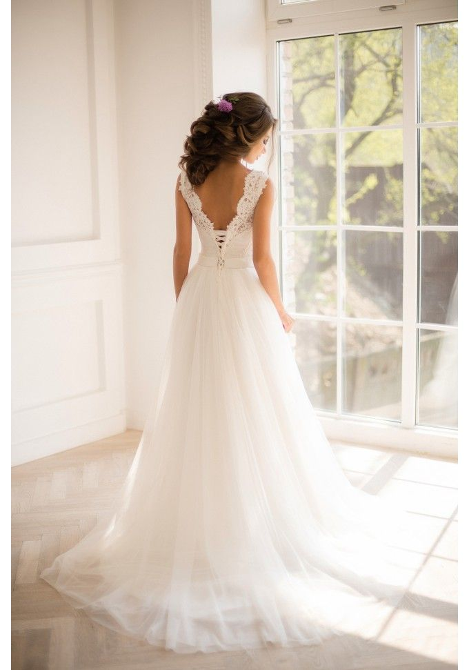 Dress to impress with this sophisticated wedding dress that features both an illusion neckline and a delicate lace V-back embellished with floral appliqué. A lavish satin skirt completes the look, making this the perfect choice for your big day.
