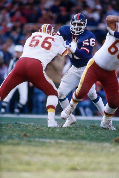 Joe Jacoby of the Washington Redskins & Lawrence Taylor of the New York Giants square off.