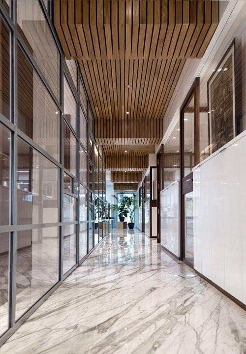 Wooden ceiling, steel facade, storage wall, Statuatio marble floor, office design, passage, corporate