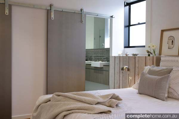 We love the custom made sliding door helps maintain the aesthetic of the calming bedroom