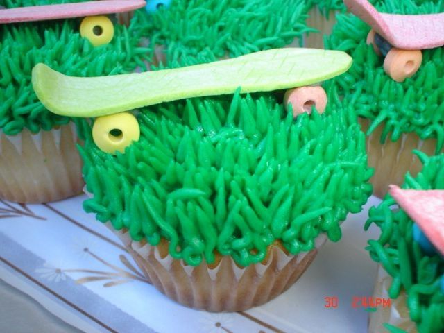 vanilla cupcakes, skateboard is a stick of gum shaped like a board and candy wheels