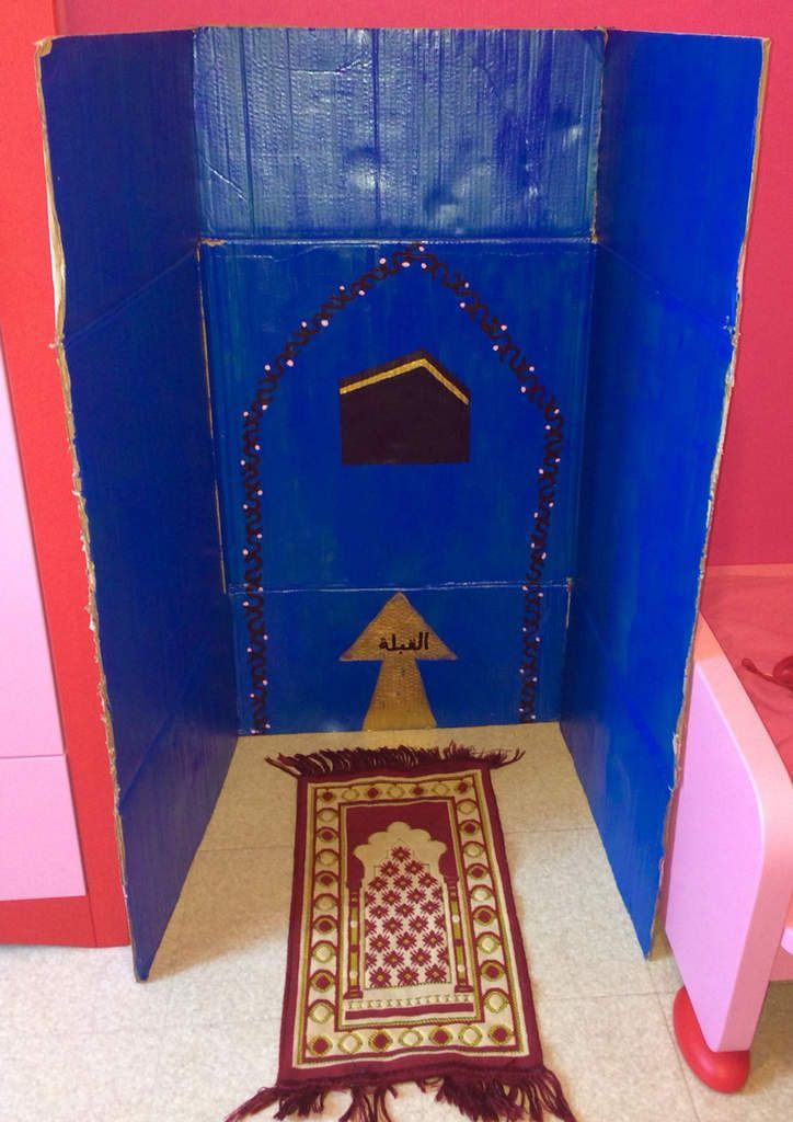 Kids create the own mini mihrab salat area for there room using a card board box and paints too cute :)
