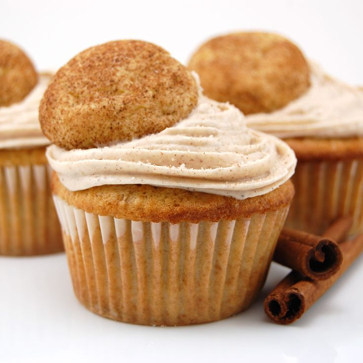 Snickerdoodle cupcakes swirled with cinnamon cream cheese frosting and topped with a