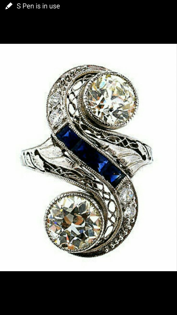 This was my dream ring, the first art nouveau one I ever saw.  I love the very delicate filigree and the length of it, but not the sapphire or the two-stone aspect because it doesn't feel like an engagement ring.