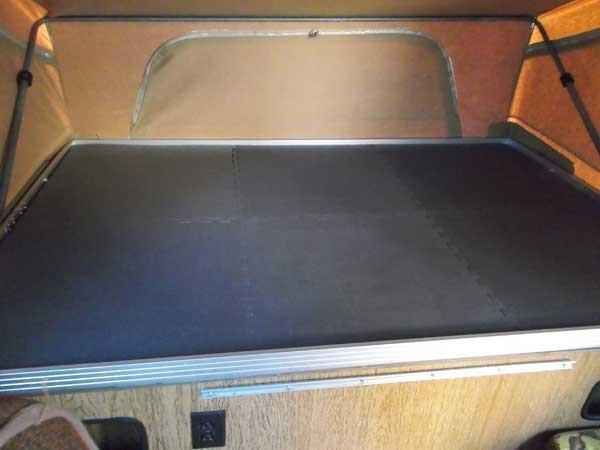 Anti-fatigue floor mats on the bottoms of bunks add comfort and insulation. | 37 RV Hacks That Will Make You A Happy Camper