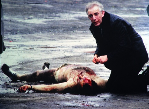 Priest giving last rites to dying british soldier in Milltown Northern Ireland 1986.
