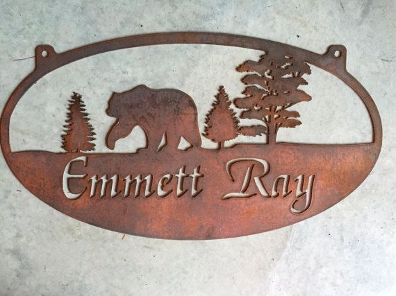 Rustic, personalized metal sign with bear in forest scene . Measures 32 x 17.7. Powder coated black or beautiful rustic copper acid and clear coated, . Makes a very attractive entrance sign.Included with the price is customizing with your name.Our finish is a baked on powder coat for a very long lasting durable finish. PLEASE LEAVE NOTE TO SELLER WITH NAME AND OR EST. DATE YOU WANT ON SIGN