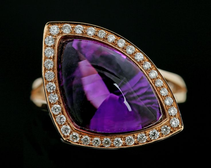 An upside down polished cabochon cut Amethyst , surrounded by brilliant cut Diamonds in 18 carat rose gold
