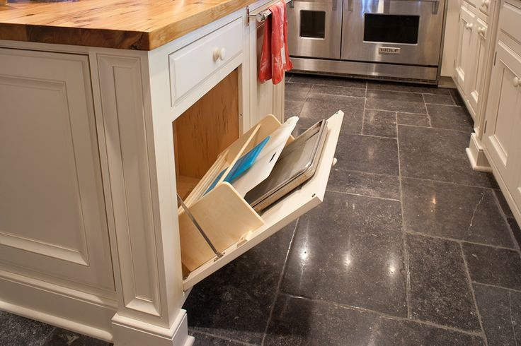 Cookie Sheets and Cutting Board storage behind tilt-out door in kitchen base cabinet (image via Keystone Kitchen and Bath)