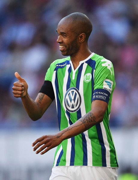 Naldo of Wolfsburg looks happy during the Bundesliga match between Hamburger SV and VfL Wolfsburg at the Volkspark stadium on May 07, 2016 in Hamburg, Hamburg.