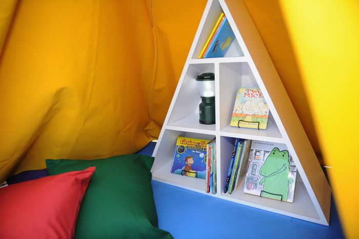 The tents had a variety of classic Houghton Mifflin Harcourt stories on a triangular bookshelf.