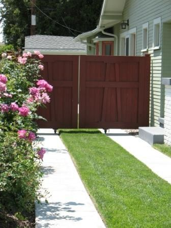Ribbon Driveway & wooden gate: found on apartment therapy & while I know this isn't a garden... I love this for when I get to redo my driveway.  I can add MORE GREEN!