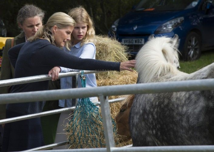 Sophie and Louise petting a pony.