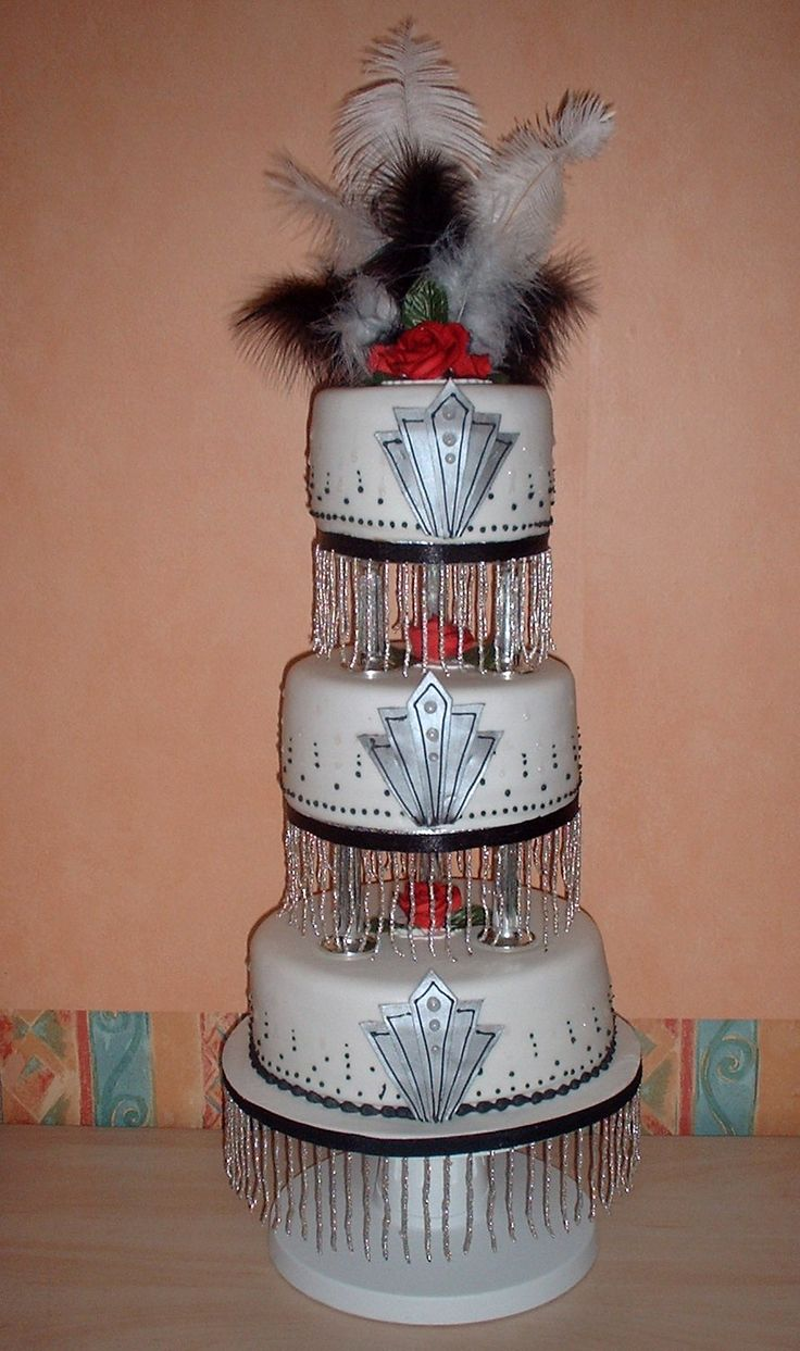 not to sure about the feathers but i love the fringe 1920's Inspired cake http://www.cake-maker.com/weddings.html