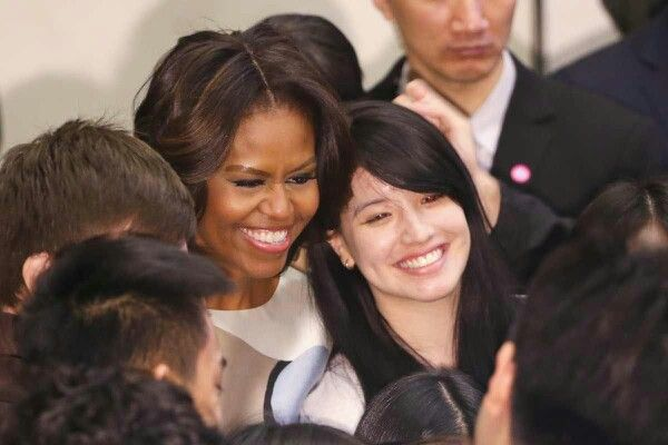 U.S. First Lady Michelle Obama takes pictures with students after delivering a speech at the Stanford Center at Peking University on March 22, 2014 in Beijing, China