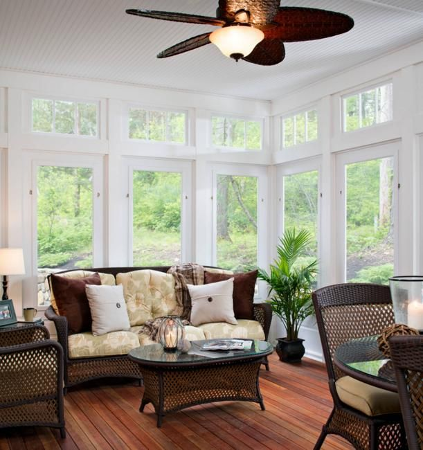 sun room design with large windows and home furnishings