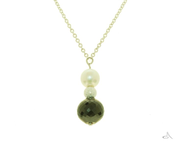 A faceted black spinel, sterling silver and freshwater pearl pendant