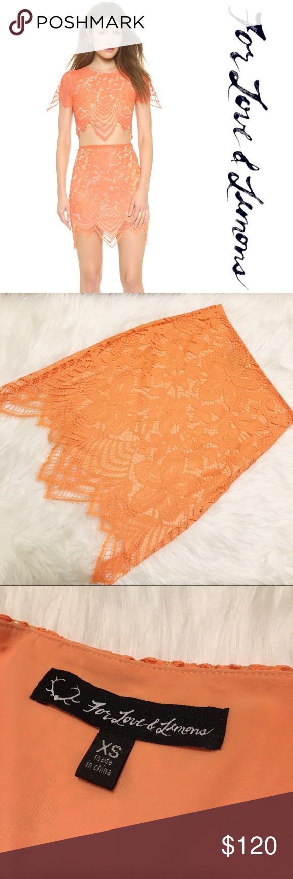 """For Love & Lemons Guava Lace Mini Skirt EUC • Guava Lace Mini skirt in Tropical Orange • Pairs perfectly with the Luna Lace Crop top • NOTE: THIS LISTING IS FOR THE SKIRT ONLY • invisible side zipper   - Size: XS - Material: pictured   - Style: lace mini skirt  -Stretch: no  -Lined: yes   *Measurements (approximation taken laying flat): *   Waist: 12""""  Length: 16.5"""" at shorted, 20"""" at longest  Hips: 16.5"""" For Love And Lemons Skirts Mini"""