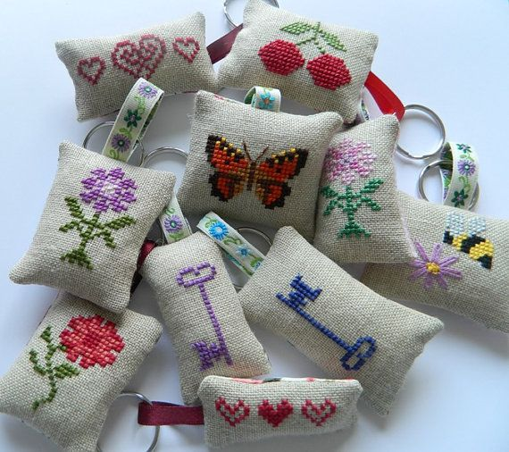 These cute little key rings have been hand stitched with love by me. Each has a different motif which has been cross-stitched on linen, with
