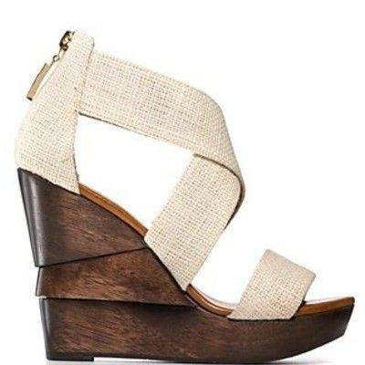 I love the contrasting burlap strap and chocolate stained wood wedge of