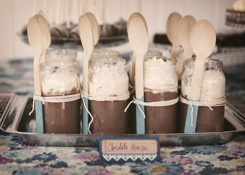 A silver tray was lined with glass jars that were filled with yummy chocolate mousses which were decorated with aqua dipped wooden spoons and cotton twine.