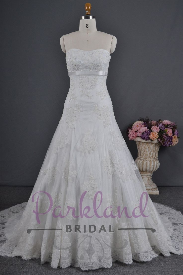 http://www.parklandbridal.co.nz/Store/tabid/4393/ProdID/33795/CatID/358/Parkland_Bridal_Emme.aspx  A beautiful strapless gown with a satin band under the bust. Embellished all over with gorgeous lace and luxury beading.