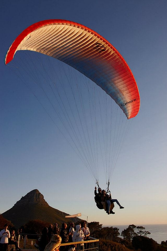 Here at Fly Cape Town Paragliding we love to paraglide and your pilot will stay in the air with you for as long as possible. Our landing fields are either at the Camps Bay High school sports field in front of the Bungalow restaurant or at the Seapoint promenade in front of the Winchester Mansions. The landing area depends on the general wind direction on the day. The cost of a tandem paragliding flight is R950.