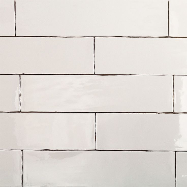Simple white subway tile in an updated more slender size keep it traditional but more modern - White brick tiles black grout ...
