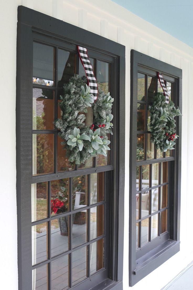 Black paned windows with Christmas Wreaths.
