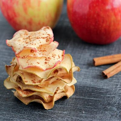 Baked Cinnamon Apple Chips     4 apples, sliced thin on a mandoline, or if your knife skills are that good, have at it that way.*   1 tsp granulated sugar  1 tsp ground cinnamon