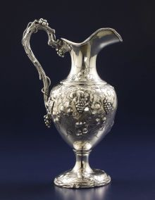 An American Silver Ewer -   William Kendrick, Louisville, Kentucky -  Circa 1870,  Silver,  Marks: W.KENDRICK, STERLING, 2,  15.75 inches high,  37.28 troy ounces.    The baluster-form ewer with engraved and repoussé grape cluster and vine decoration, with cast branch, vine and cluster handles. Based on the model created by John C. Moore for Tiffany & Co. around 1850. Monogrammed interlaced W
