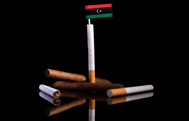 libyan flag with cigarettes and cigars tobacco industry concept
