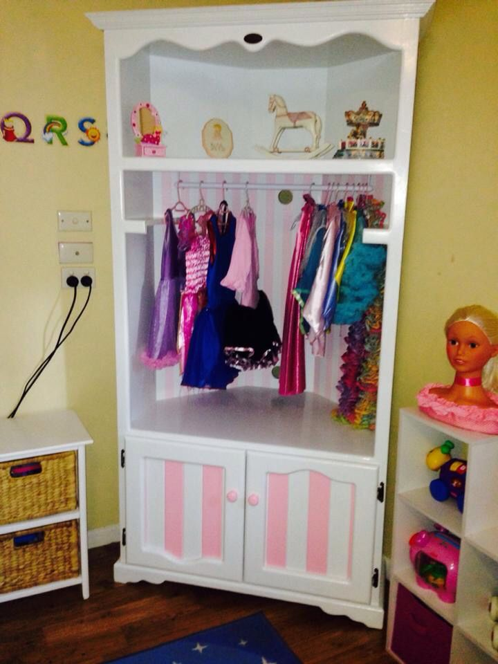 DRESS UPS CUPBOARD! Made from an unwanted TV cabinet. Pink and white stripes!