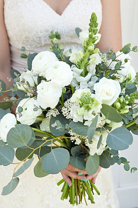"""Something Turquoise Bouquet Blueprint: 5 Stems of Snap Dragons     1/5 Bunch Silver Dollar Eucalyptus     1/5 Bunch of Spiral Eucalyptus     10 stems Ranunculus     6 stems """"Akito"""" roses     2 stems Rice Flower"""