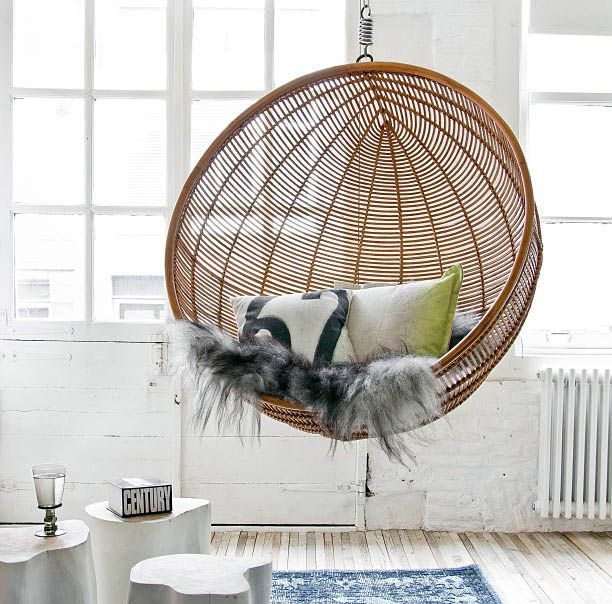 Round wicker hanging chair with comfy faux fur