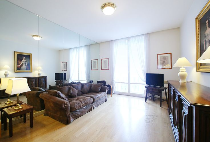 #sanbabila #twobedroomsapartment : beautiful and cozy living room with a comfortable sofa for the TV. incredible view on the church of Piazza San Babila and Corso Venezia. wooden floors throughout. double windows