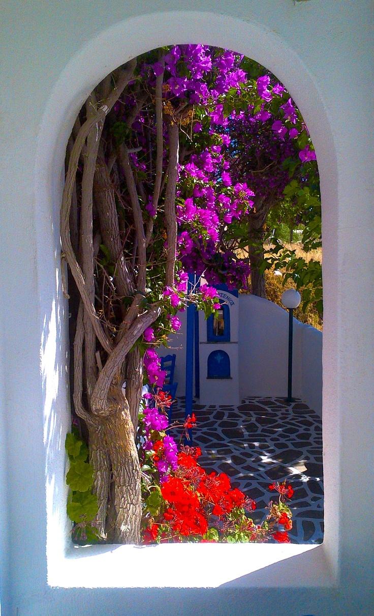 Peeking into the courtyard in Skala, Kefalonia, Greece
