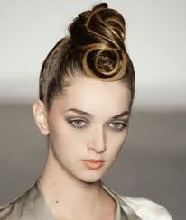Google Image Result for http://static.becomegorgeous.com/img/arts/2010/Aug/05/2533/modern_updo.jpg