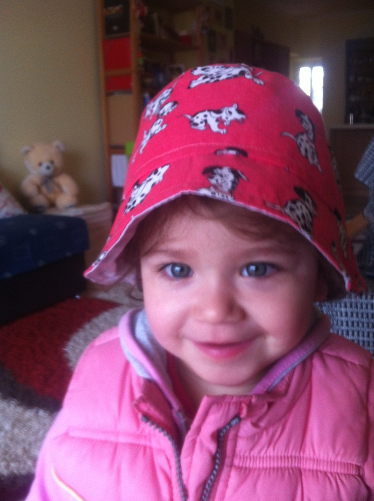 My sweet little girl with a spring doggy hat!!!