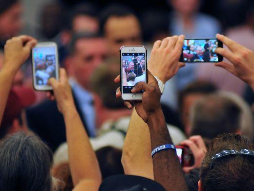 Cellphone cameras capture the moment as Sen. Tim Kaine,