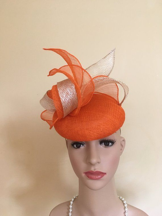 073757573a4a7 This delightful hat is handmade in a beautiful orange and light gold  sparkly sinamay to catch the light and add glamour. The base is orange and  the top is ...