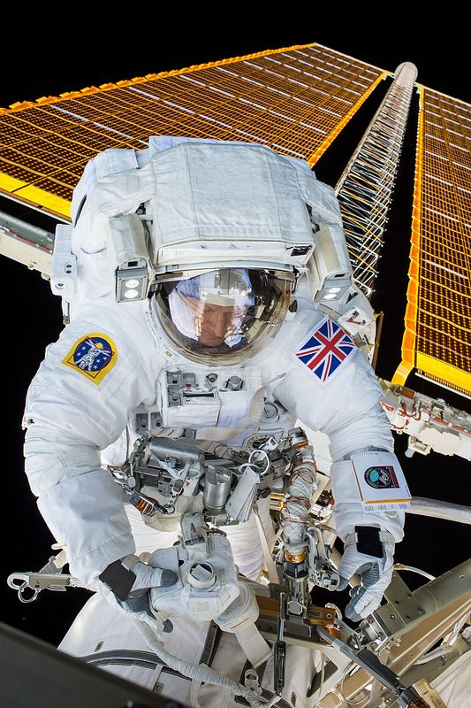 "spaceexp: "" European Space Agency astronaut Tim Peake seen during his first spacewalk. Peake and NASA astronaut Tim Kopra successfully replaced a failed voltage regulator on Jan. 15, 2016. Peake is the first astronaut to wear a Union Jack patch..."
