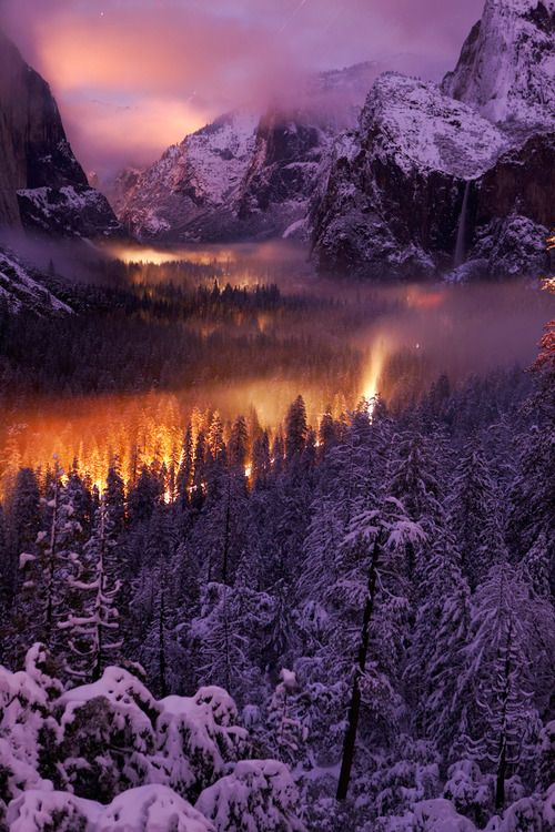 """Yosemite Valley at Night - The mist on the valley floor reflects car lights driving through ~"