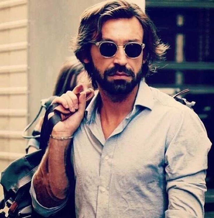 Pirlo just walking down the street, holding a bag, probably to going to get some milk or something
