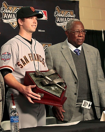 Buster Posey, National League MVP finalist  San Francisco Giants catcher Buster Posey holds the Hank Aaron Award with Hall of Famer Hank Aaron during a presentation ceremony before Game 3 of the MLB World Series baseball championship between the Giants and the Detroit Tigers in Detroit, Michigan, October 27, 2012. REUTERS/Rebecca Cook (UNITED STATES - Tags: SPORT BASEBALL)