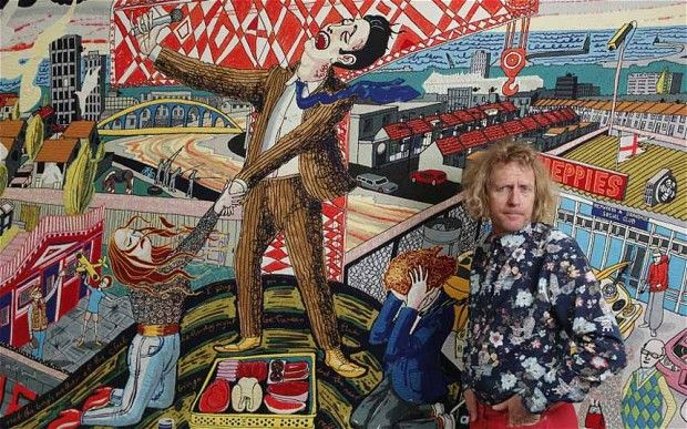 Grayson Perry pictured in front of tapestry The Agony in the Car Park at the Victoria Miro Gallery in summer.